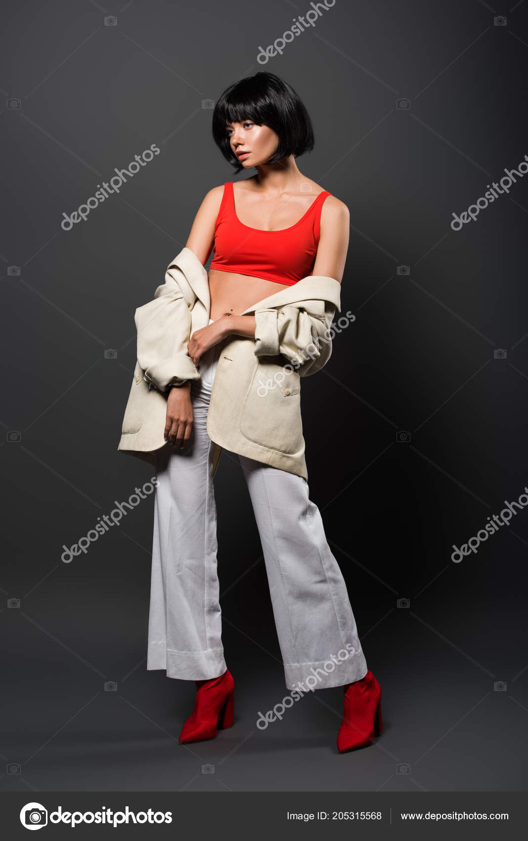 Beautiful Young Woman Bobbed Hair Red Crop Top Bell Bottoms Stock