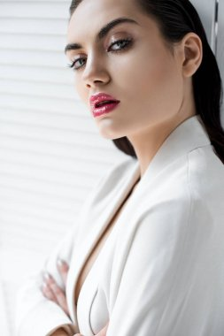 brunette woman posing in white fashionable jacket