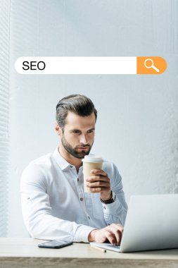 Concentrated developer holding coffee to go while working with laptop with SEO search bar stock vector