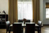 Photo interior view of stylish dining room with table, chairs and big window