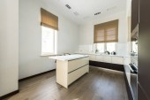 Fotografie interior view of empty modern kitchen with furniture in light colors