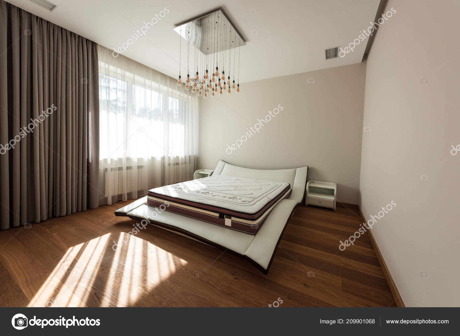 Interior modern bedroom bed light bulbs ceiling u stock photo y
