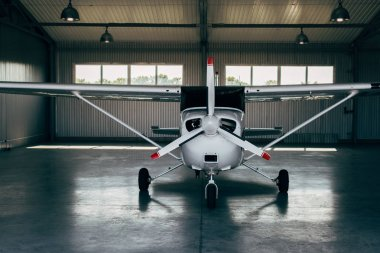 modern small airplane standing in hangar