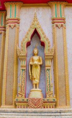 The golden buddha statue.