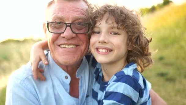 Closeup portrait of a happy grandfather and grandson. Mature father and son is a schoolboy. Late child. Happy Family Vacation