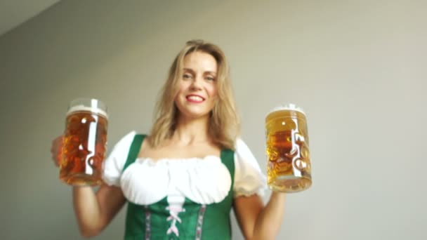 Beautiful and cheerful waitress in traditional german costume holding beer glasses on Oktoberfest. White-tooth-smile and red lipstick