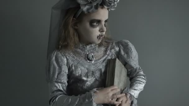 A Portrait Of A Beautiful Zombie Corpse Bride Looked Scary. Girl In A Witch  Costume With A Book Of Spells In Their Hands. Halloween Brideu2013 Stock Footage