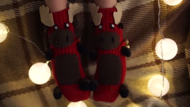 Knitted socks in the form of funny deer
