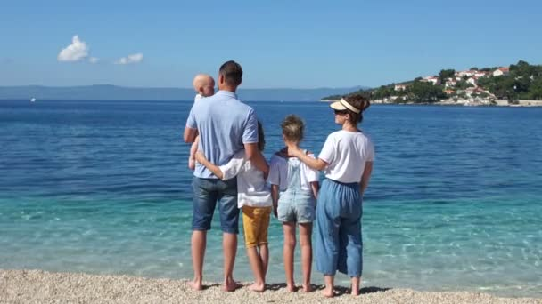 Family with three children on the shores of the Mediterranean. Holidays in Croatia, family travel concept