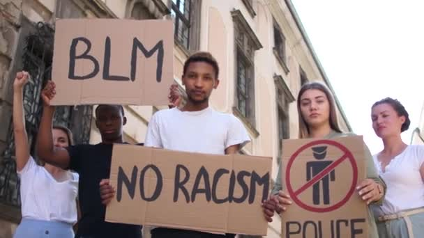 Peaceful Black Lives Matter Protest City Street. Mass protests in the usa. Multiracial group of people with posters blm, police free zone, no racism. Rallies against racism and police brutality