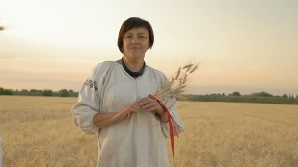 Slow Motion, Two Women in National Costumes on the Wheat Field with Wheat Spikes in Hands Linked by Red Ribbon