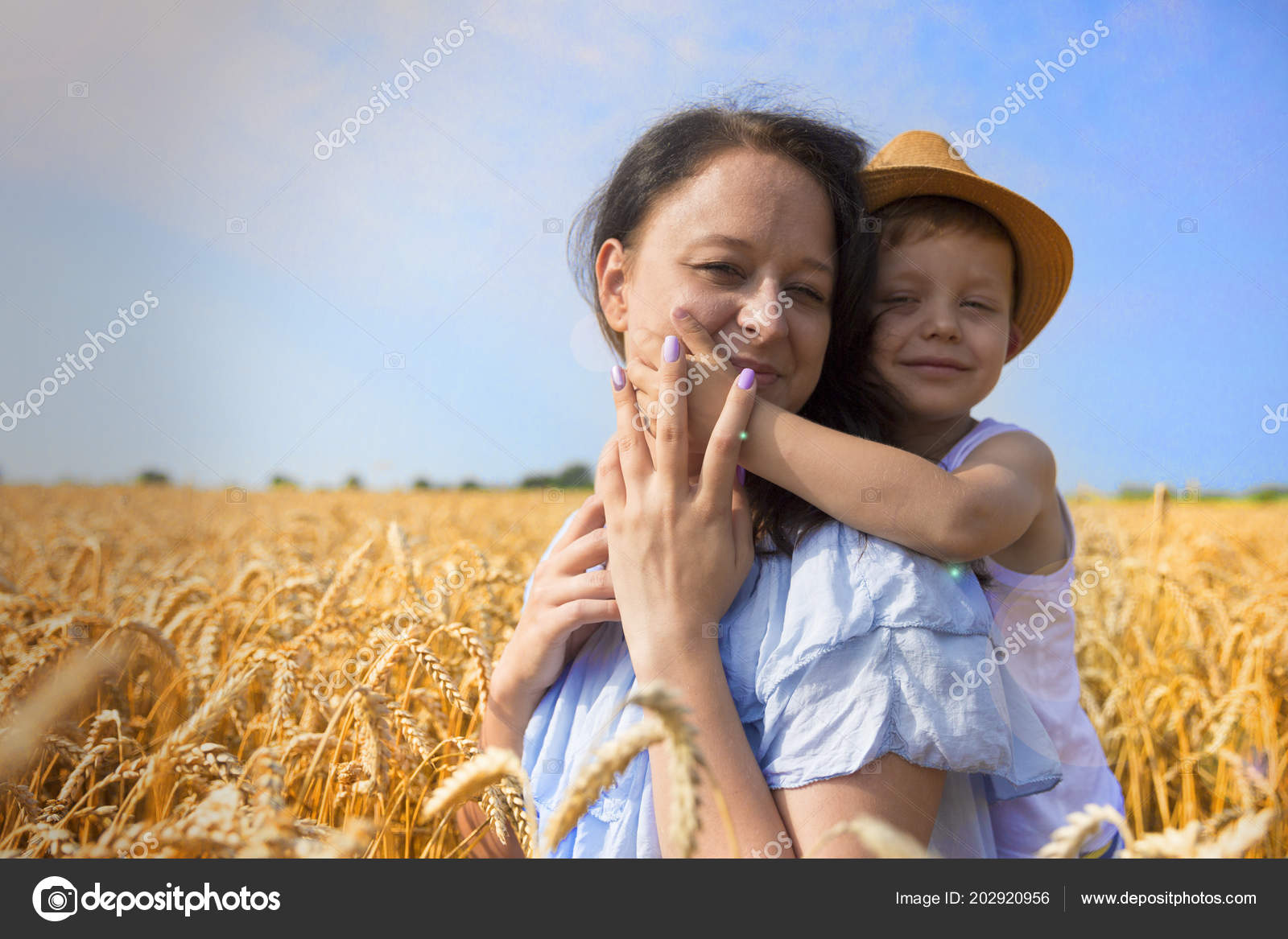 Mom and son are laughing and talking on the wheat field. Front view. —  Photo by anastasiyparfenyuk