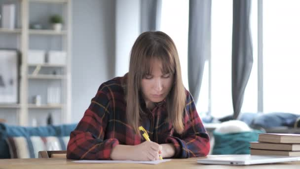 Casual Young Girl Writing an Article, Paperwork
