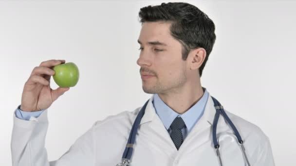 Doktor zobrazeno zelené jablko, zdravotní péče