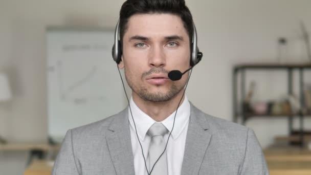 Call Center Businessman Talking via Headphones