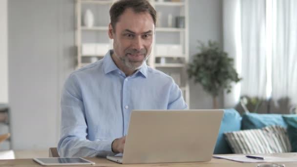 Businessman Celebrating Success on Laptop