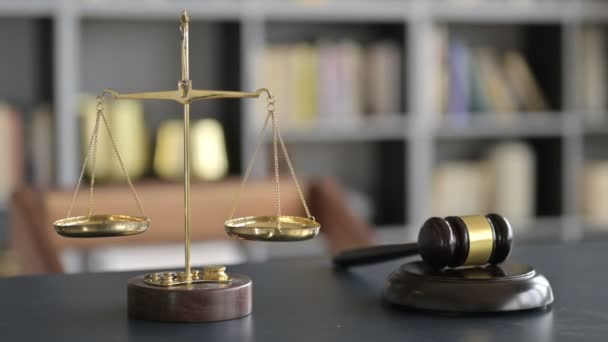 Gavel and Gold Brass Balance Scale on Lawyer Office Table