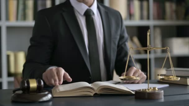 Close up Shoot of Lawyer Hands Reading Book on Court Desk