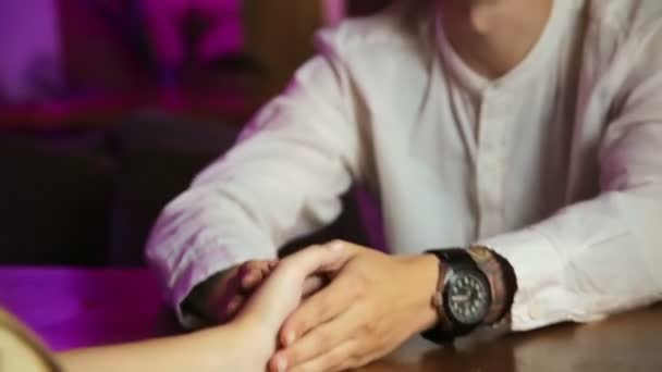 Young couple of lovers are sitting in a cafe, drinking coffee happy smiling Hands close up