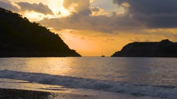 Beautiful sunset at beach, light beam Turkish seascape, Marmaris, Turkey
