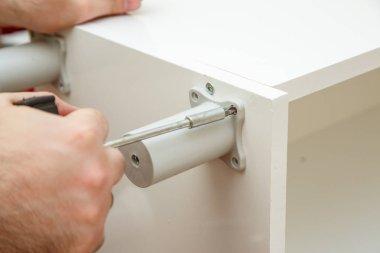 male hands twist screw