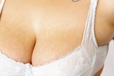 young overweighted woman in lingerie on white isolated backgroun
