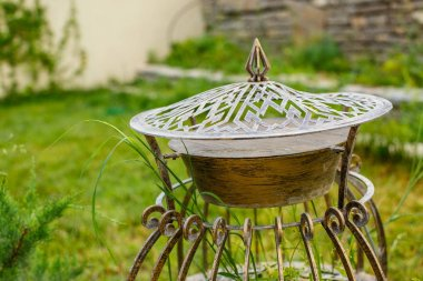 vintage metal garden lantern on green lawn