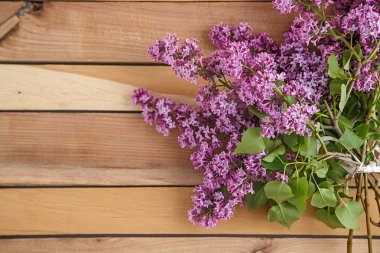 lilac branch on a wooden background . the view from the top .