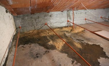 wide attic with dampness under the roof and the water