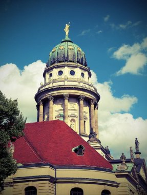 Dome of the twin church called the Cathedral of the French in Berlin, Germany with vintage effect