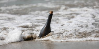 wavees of sea and a bottle of glass