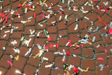 colored confetti during the carnival party on the paved floor