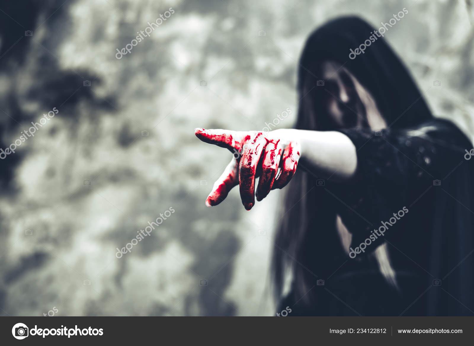 depositphotos_234122812-stock-photo-close-bloody-ghost-hand-pointing.jpg