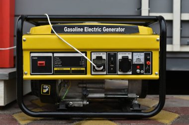 yellow gasoline electric generator