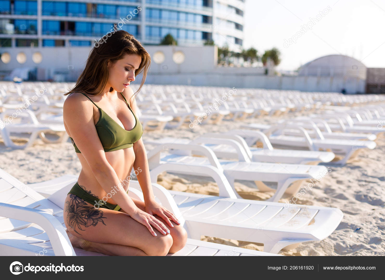 5030e7606d Beautiful woman wearing bikini and tanning on the beach– stock image