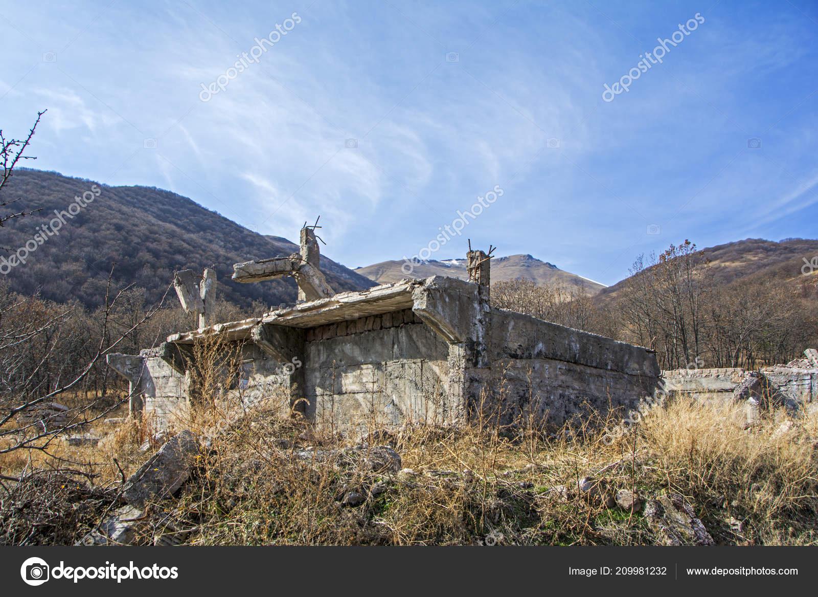 apocalyptic landscape destroyed building wasteland mountains