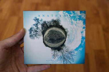 Bratislava, Slovakia, july 3, 2018: Anathema - Weather Systems music CD with laminate wood background