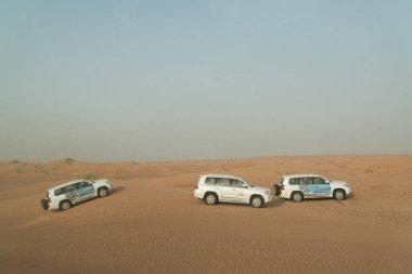 DUBAI - JUNE 17, 2014 - Dune bashing on Arabian desert near Dubai, United Arab Emirates