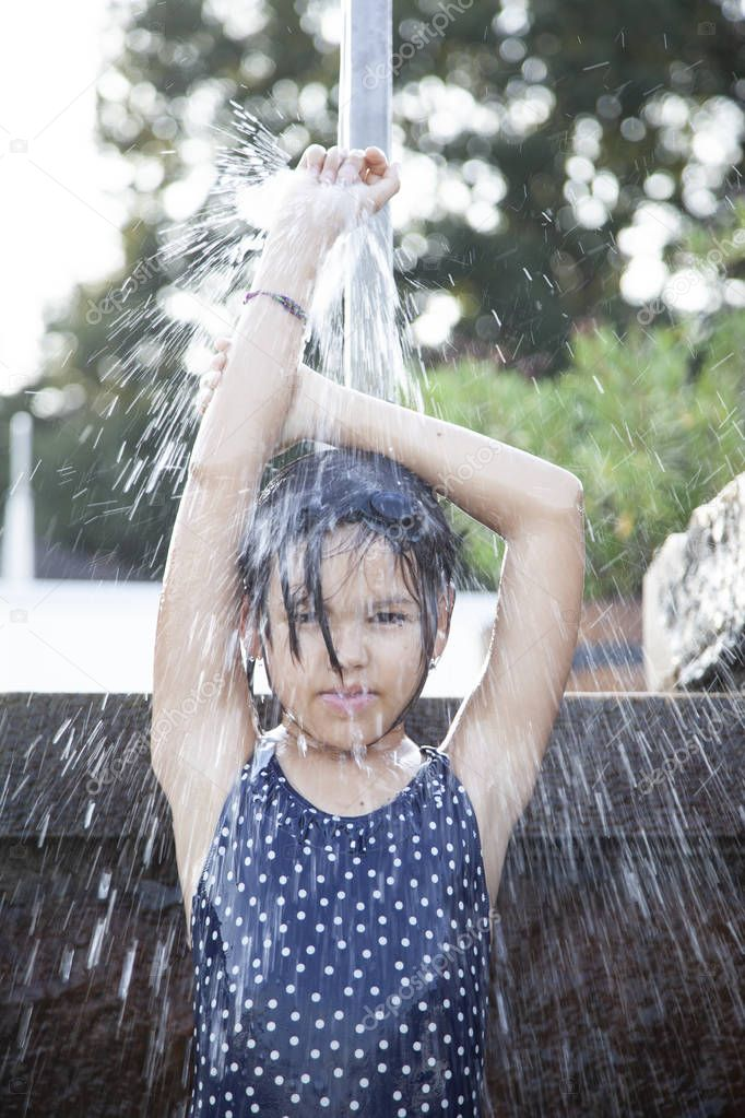 child taking shower outdoors.