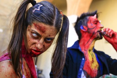 Cosplay dressed as zombies and devil