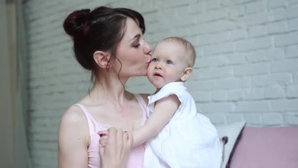 Happy Mother and Baby kissing and hugging, Resting in bed together, Maternity concept Motherhood Beautiful Happy Family