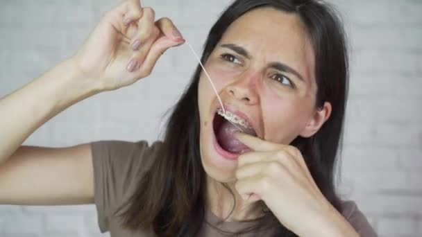 Dental floss. Portrait of girl. Teeth cleaning, braces.