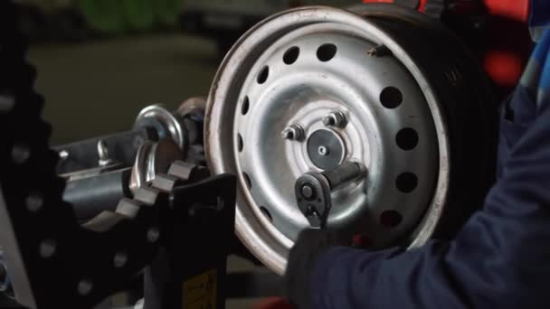 Equipment for car service and repair - tire machine for rolling and alignment of steel wheel rims close-up