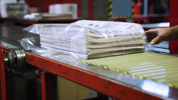 recently printed newspaper in the printing house, Packed for distribution