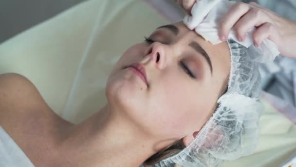 Beauty clinic. A woman gets beauty facial cosmetology procedure.