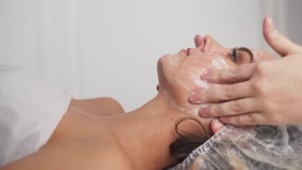 Beauty clinic. A woman gets beauty facial cosmetology procedure.