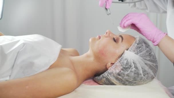 Beauty clinic. A woman gets beauty facial cosmetology procedure