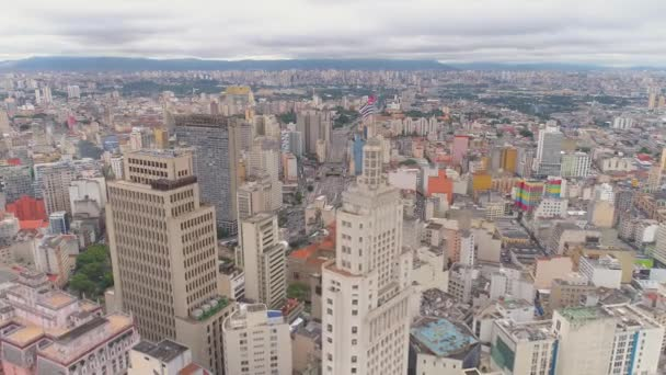 SAO PAULO, BRAZIL - MAY 3, 2018: Aerial View of the city centre Banespa building with city flag. Landmark touristic place. Drone shot in 4K