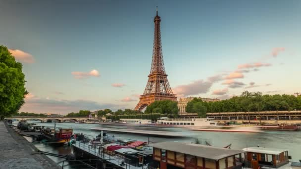 PARIS, FRANCE - JUNE 19, 2018: Eiffel Tower day timelapse. Fast movement. Sunny day with clouds. 4K shot