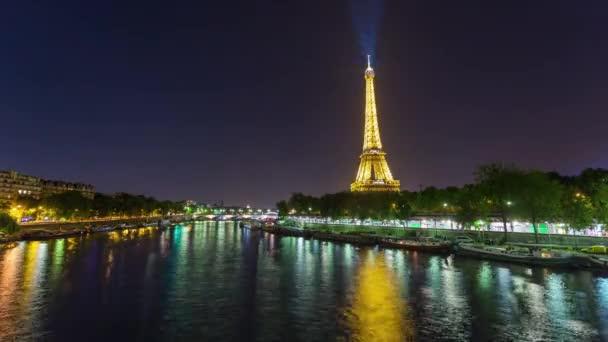 PARIS, FRANCE - JUNE 19, 2018: Eiffel Tower night timelapse bright lights. Fast movement. 4K shot